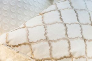 detail of white and tan pillow