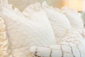 detail of white and tan pillows
