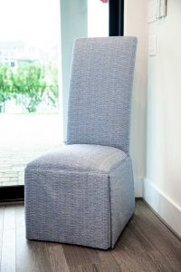 blue fabric upholstered chair