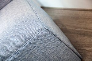 detail of blue fabric upholstered chair